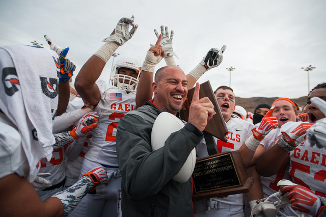 Bishop Gorman head coach Tony Sanchez celebrates with his team after winning the NIAA Division I state title Saturday in Reno. Gorman won its sixth straight state title by downing Reed, 70-28. (Ph ...