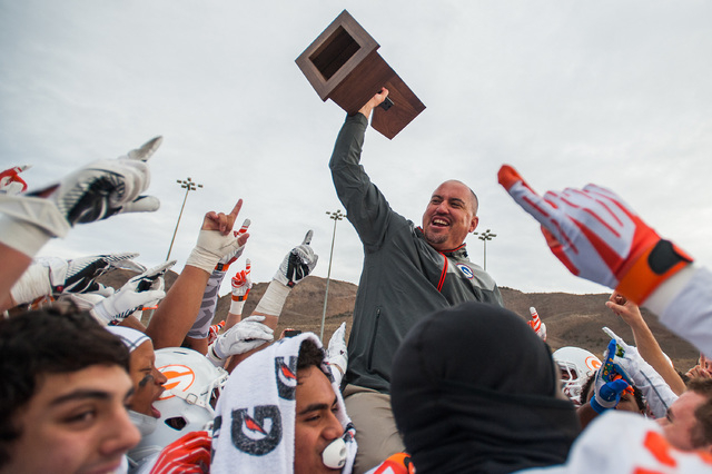 Bishop Gorman head coach Tony Sanchez celebrates the Gaels' 70-28 win over Reed in the Division I state title game in Reno on Saturday. It's the sixth straight state title for Gorman, ranked No. 1 ...