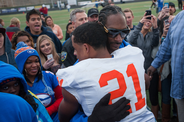 Bishop Gorman's Cordell Broadus (21) celebrates with his father Snoop Dogg after winning the Division I state football title in Reno. Bishop Gorman beat Reed, 70-28. (Photo by Kevin Clifford/Speci ...