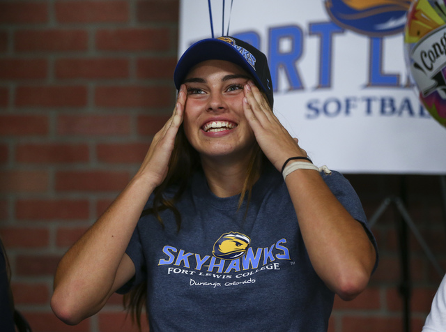 Arbor View softball player Taylor Beaman reacts as Las Vegas area high school softball players gather to sign their national letters of intent at PrimeTime batting cages in North Las Vegas on Wedn ...
