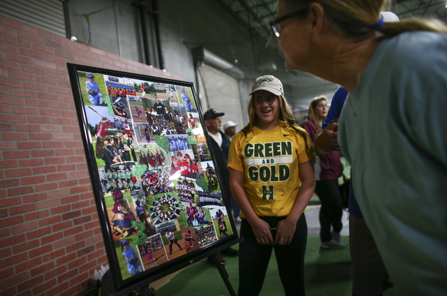Arbor View softball player Breanne Henricksen looks on as people gather to watch Las Vegas area high school softball players sign their national letters of intent at PrimeTime batting cages in Nor ...