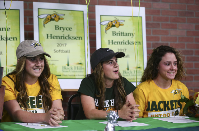 Arbor View softball players and triplets, from left, Breanne, Bryce, and Brittany Henricksen prepare to sign their national letters of intent at PrimeTime batting cages in North Las Vegas on Wedne ...