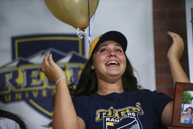 Centennial softball player Brianna Benoit reacts as Las Vegas area high school softball players gather to sign their national letters of intent at PrimeTime batting cages in North Las Vegas on Wed ...