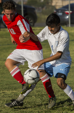 Arbor View junior midfielder Nicklaus Dongmannon (12) fights for possession with Canyon Springs senior defender Alejandro Reveles (4) on Tuesday, Sept. 6, 2016, at Canyon Springs High School in La ...