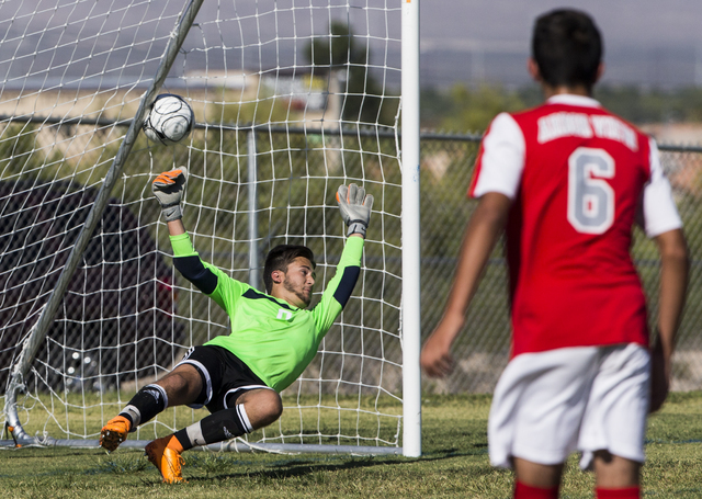 Arbor View senior goal keeper Brendan Rapp (0) attempts to stop a shot as freshman midfielder Ethan Boone (6) watches on Tuesday, Sept. 6, 2016, at Canyon Springs High School in Las Vegas. The Pio ...