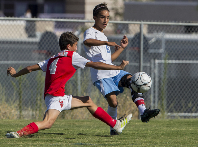 Canyon Springs junior midfielder Edgar Donate (6) makes a pass around Arbor View sophomore defender Hayden Turnier (4) on Tuesday, Sept. 6, 2016, at Canyon Springs High School in Las Vegas. The Pi ...