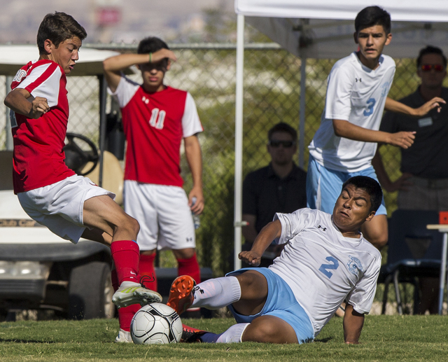 Canyon Springs sophomore midfielder Chris Mata (2) slide tackles Arbor View sophomore defender Hayden Turnier (4) on Tuesday, Sept. 6, 2016, at Canyon Springs High School in Las Vegas. The Pioneer ...