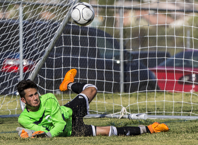 Arbor View senior goal keeper Brendan Rapp (0) punches a ball out of danger on Tuesday, Sept. 6, 2016, at Canyon Springs High School in Las Vegas. The Pioneers defeated the Aggies 4-1. Benjamin Ha ...