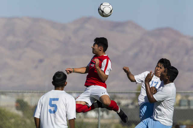 Arbor View sophomore forward Marcos Martinez (11) fights for possession with Canyon Springs defenders on Tuesday, Sept. 6, 2016, at Canyon Springs High School in Las Vegas. The Pioneers defeated t ...