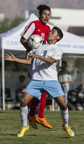 Canyon Springs junior midfielder Edgar Muniz (9) fights for possession with Arbor View junior defender Antonio Luna (21) on Tuesday, Sept. 6, 2016, at Canyon Springs High School in Las Vegas. The  ...