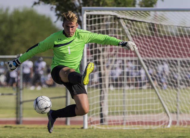 Arbor View senior goal keeper Gabriel Sano (1) clears a shot on Tuesday, Sept. 6, 2016, at Canyon Springs High School in Las Vegas. The Pioneers defeated the Aggies 4-1. Benjamin Hager/Las Vegas R ...