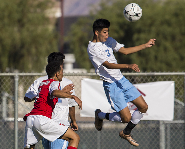 Canyon Springs junior midfielder Chris Lopez (3) leaps for a header on Tuesday, Sept. 6, 2016, at Canyon Springs High School in Las Vegas. The Pioneers defeated the Aggies 4-1. Benjamin Hager/Las  ...