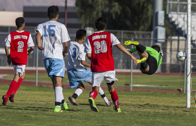 Arbor View senior goal keeper Gabriel Sano (1) watches a shot hit the cross bar on Tuesday, Sept. 6, 2016, at Canyon Springs High School in Las Vegas. The Pioneers defeated the Aggies 4-1. Benjami ...