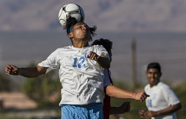 Canyon Springs junior midfielder Alejandro Perez (12) leaps for a header on Tuesday, Sept. 6, 2016, at Canyon Springs High School in Las Vegas. The Pioneers defeated the Aggies 4-1. Benjamin Hager ...