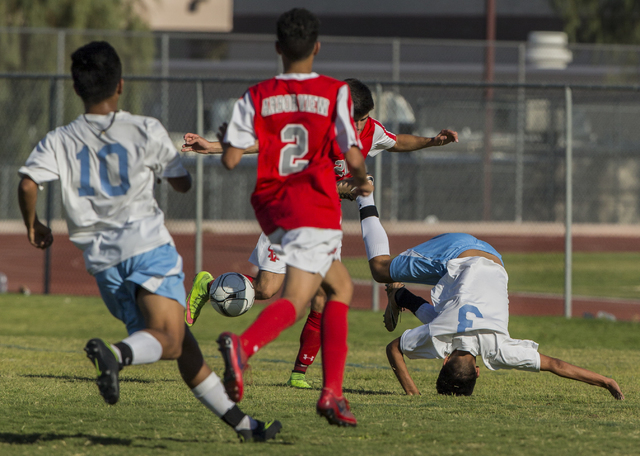 Canyon Springs junior midfielder Chris Lopez (3) gets up-ended making a run at the goal on Tuesday, Sept. 6, 2016, at Canyon Springs High School in Las Vegas. The Pioneers defeated the Aggies 4-1. ...
