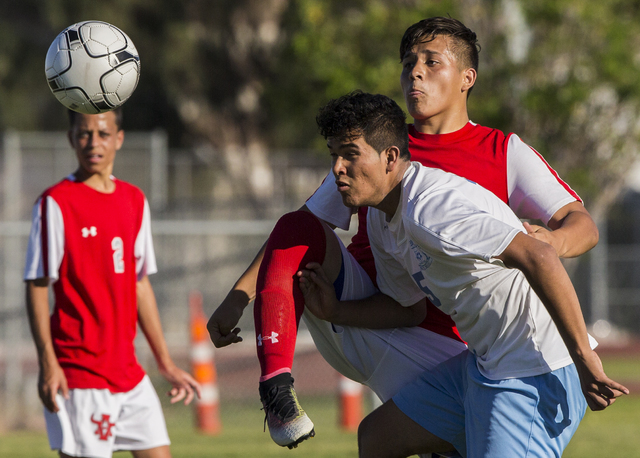 Canyon Springs senior forward Juan Covarrubias-Conchas (15) fights for possession with Arbor View senior defender Christian Limon (13) on Tuesday, Sept. 6, 2016, at Canyon Springs High School in L ...