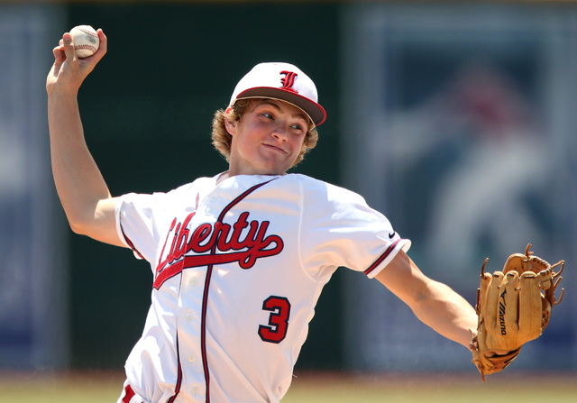 Liberty's Trevor Mullaney pitches against Centennial in the Division I state championship game on Saturday. Mullaney allowed two runs on six hits in six innings to get the victory as Liberty defea ...