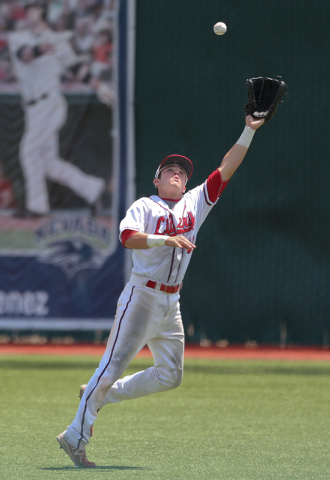 Liberty right fielder Jesse Keiser makes a catch against Centennial during the Division I state final Saturday at Reno. Liberty defeated Centennial 5-3 to win the championship. (Cathleen Allison/S ...