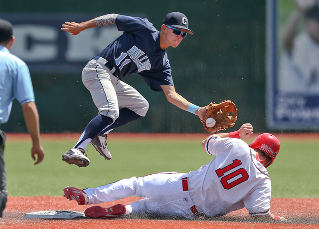 Liberty's Dan Skelly steals safely under the tag of Centennial's Tanner Wright during the Division I state championship game on Saturday. Liberty defeated Centennial 5-3 to win the title. (Cathlee ...