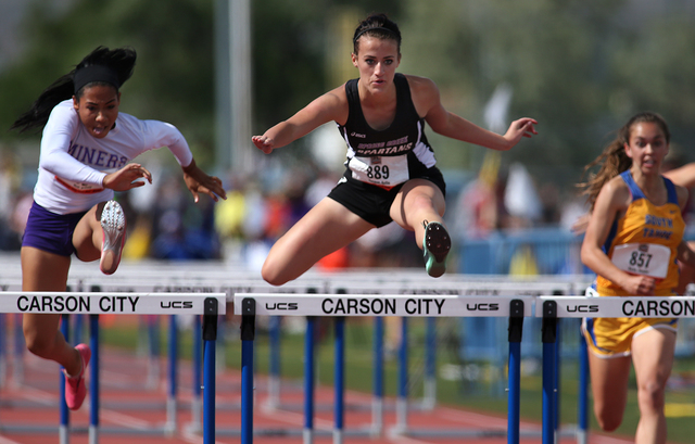 Sunrise Mountain's Brittany Veal, left, runs in the 100-meter hurdles during the Division I-A state track meet on Friday. Veal finished second in 15.36 seconds. Spring Creek's Kellie Kinsman, cent ...