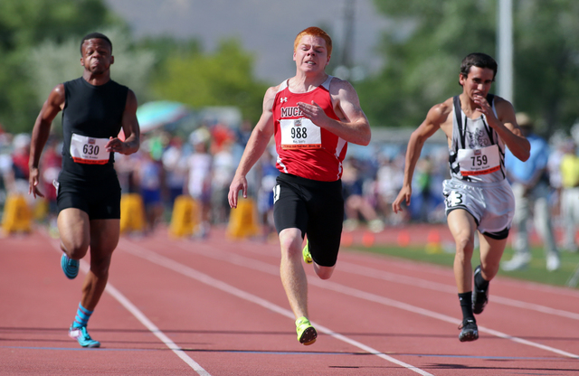 Tonopah's Scotty May, center, wins the Division IV boys 100-meter dash with a time of 11.47 the state track meet on Friday. (Cathleen Allison/Las Vegas Review-Journal)