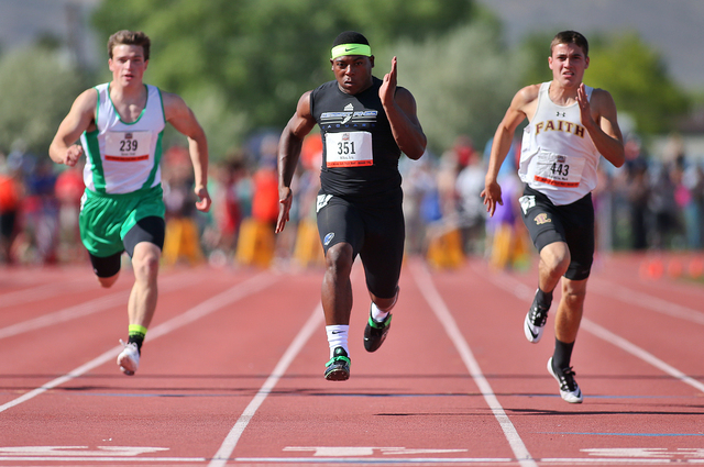 Desert Pines' Eric Wilkes, center, wins the Division I-A boys 100-meter dash with a time of 10.92 seconds during the state track meet on Friday. Faith Lutheran's Mark Rubalcaba, right, was second  ...
