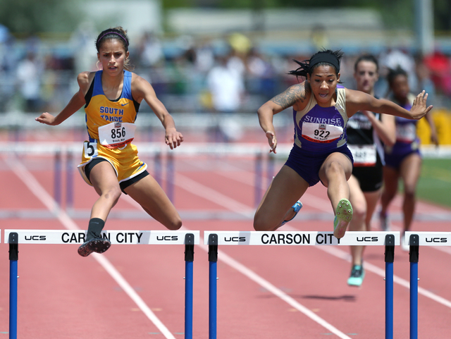 Sunrise Mountain's Brittany Veal, right, wins the Division I-A girls 300-meter hurdles with a time of 44.55 seconds, just ahead of South Lake Tahoe's Maya Brosch at 44.59. (Cathleen Allison/Specia ...