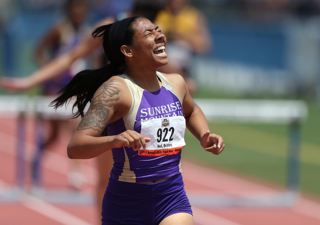Sunrise Mountain's Brittany Veal reacts to winning the Division I-A girls 300-meter hurdles title with a time of 44.55 seconds on Saturday. (Cathleen Allison/Special to the Review-Journal)