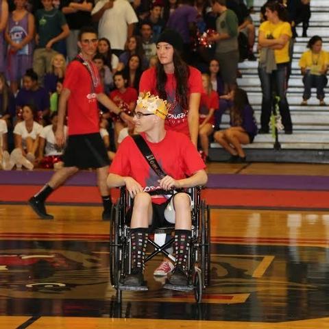 Brooke Lynn Garlick, a senior at Coronado, wheels out Michael Tatalovich at the Homecoming Assembly on Oct. 11, 2013. (courtesy Michael Tatalovich)