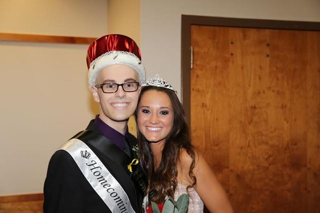 Homecoming King Michael Tatalovich, a cancer survivor, poses with Homecoming Queen Logan Lucas on Oct. 12, 2013. (courtesy Michael Tatalovich)