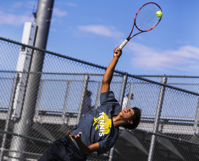 Clark High School's Marcus Pasimio fires a first serve during a home tennis meet against Bonanza High School on Tuesday, Sept. 13, 2016, at Clark High School, in Las Vegas. Benjamin Hager/Las Vega ...