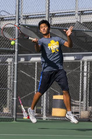 Clark High School's Marcus Pasimio hits a forehand return during a home tennis meet against Bonanza High School on Tuesday, Sept. 13, 2016, at Clark High School, in Las Vegas. Benjamin Hager/Las V ...