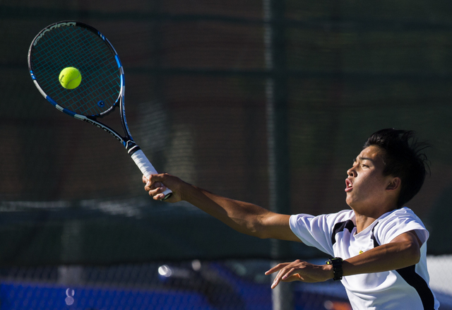 Clark High School's Michael Pasimio stretches out to return a serve during a home tennis meet against Bonanza High School on Tuesday, Sept. 13, 2016, at Clark High School, in Las Vegas. Benjamin H ...