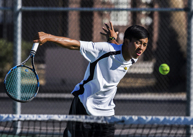 Clark High School's Michael Pasimio hits a backhand return at the net during a home tennis meet against Bonanza High School on Tuesday, Sept. 13, 2016, at Clark High School, in Las Vegas. Benjamin ...