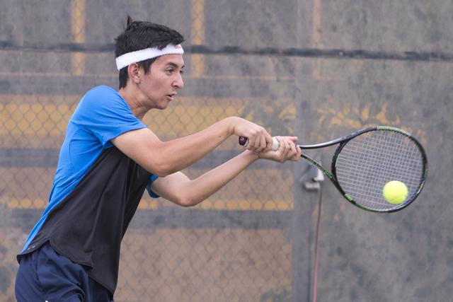 Wesley Harris from Coronado High School hits a shot during a tennis match at Liberty High School on Tuesday, Sept. 27, 2016, in Henderson. Loren Townsley/Las Vegas Review-Journal Follow @lorentownsley