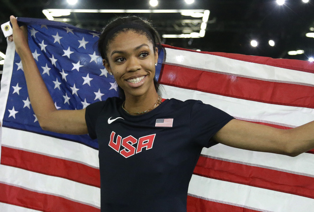 United States' Vashti Cunningham hold the U.S. flag after she won the women's high jump final during the World Indoor Athletics Championships, Sunday, March 20, 2016, in Portland, Ore. Cunningham  ...