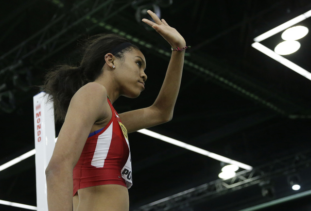 United States' Vashti Cunningham waves to the crowd after an attempt in the women's high jump final during the World Indoor Athletics Championships, Sunday, March 20, 2016, in Portland, Ore. Cunni ...