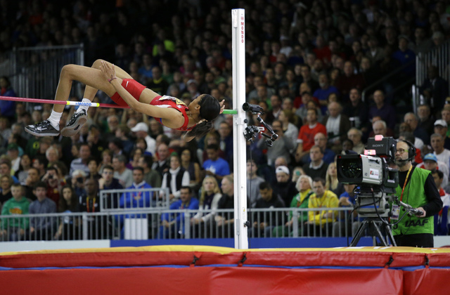 United States' Vashti Cunningham clears the bar during the women's high jump final during the World Indoor Athletics Championships, Sunday, March 20, 2016, in Portland, Ore. Cunningham won the eve ...