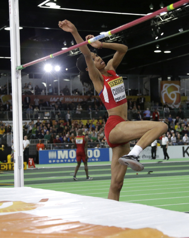 United States' Vashti Cunningham makes an attempt in the women's high jump final during the World Indoor Athletics Championships, Sunday, March 20, 2016, in Portland, Ore. Cunningham won the event ...