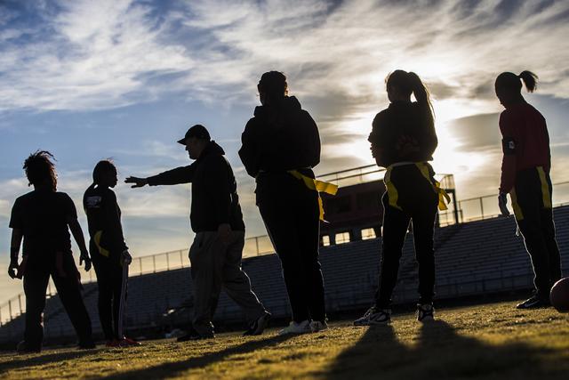 Wildcat coach Erick Capetillo explains a new play during flag football practice at Las Vegas High School on Monday, Nov. 28, 2016, in Las Vegas. Benjamin Hager/Las Vegas Review-Journal