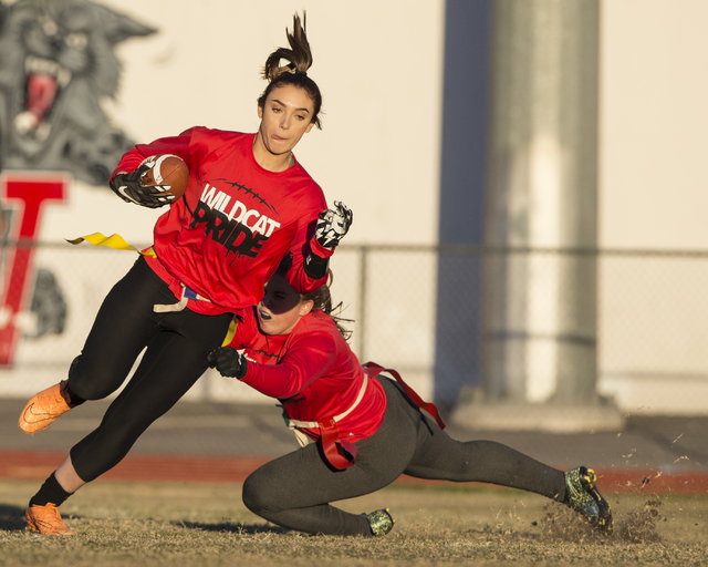 Wildcat wide receiver Natalie Gennuso, left, runs for extra yardage after a catch during flag football practice at Las Vegas High School on Monday, Nov. 28, 2016, in Las Vegas. Benjamin Hager/Las  ...