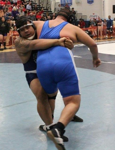 Spring Valley heavyweight Silvano Villanueva prepares to take down Sierra Vista's Roman Escobar in the 285-pound quarterfinals of the Sunset Region tournament at Centennial. (W.G. Ramirez/Las Vega ...