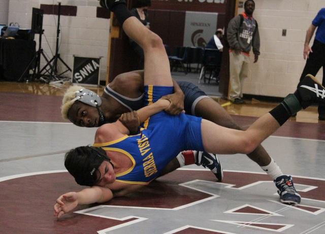 Shadow Ridge 138-pounder Nate Washington works Sierra Vista's Mark Tirre with a reverse arm bar during their quarterfinal match of the Sunset Region wrestling tournament at Cimarron-Memorial on Fr ...