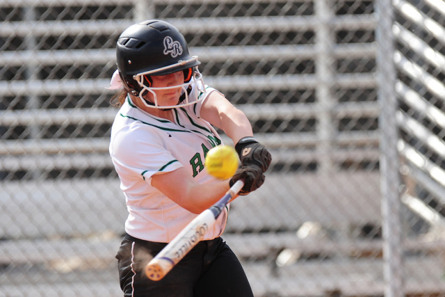 Rancho shortstop Gianna Carosone hits a three-run RBI triple with an error in the second inning of their prep softball game against Liberty at Rancho High School in North Las Vegas Thursday, April ...