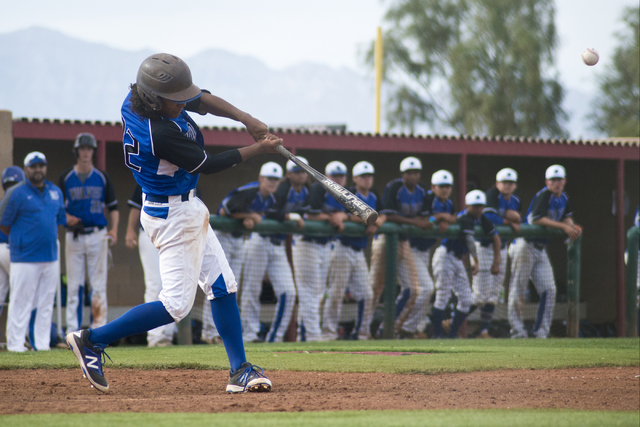 Basic's Christian Rivero (32) hits the ball during the championship game of the Lions Kick Off Tournament against Desert Oasis at Desert Oasis High School in Las Vegas on Saturday, March 12, 2016. ...