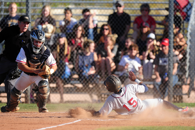 Liberty base runner Jayzen Ramirez slides home safely ahead of Coronado catcher Corben Bellamy with the go-ahead run in the seventh inning of their prep baseball game at Coronado High School in He ...