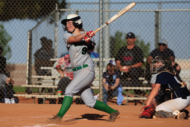 Palo Verde batter Lauryn Barker hits a three-run double in the fourth inning of their prep softball game  against Centennial at Palo Verde High School in Las Vegas Wednesday, March 16, 2016. Palo  ...