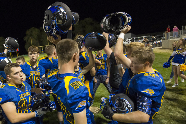 Pahranagat Valley Panthers gather for a victory chant after defeating Wells following the season opening eight-man high school football game in Alamo on Friday, Aug. 26, 2016.  (Richard Brian/Las  ...