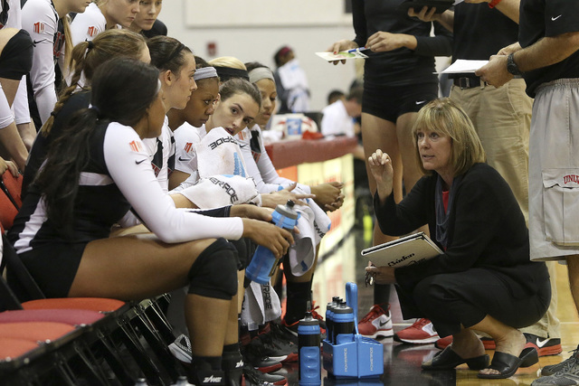 Coach Cindy Fredrick talks with her UNLV women's volleyball players during the season opener against Cal State,  Northridge in the Cox Pavilion on Aug. 29, 2014. (Aaron Mayes/UNLV Photo Services)