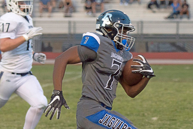 Desert Pines High School's Isaiah Morris (7) runs the ball upfield to score a touchdown during a football game against Centennial high School at Desert Pines High School in Las Vegas, Friday, Aug. ...